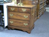 Beautiful three drawer night stand with two metal