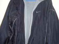 Im selling a black nike coat its reversible and the