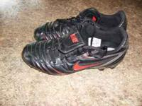 Black and silver with red swoosh. Size 9, great shape.