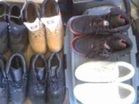 There are 2 tan timberland and 2 black, black Nike ACG