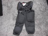 Black Nike practice or game pants with pads integrated