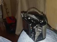Camera case included. Take 4 double a batteries. If