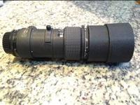 300mm F4 Nikon telephoto lens. Its an older lens but