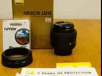 I have up for sale. A like new Nikon 35mm f/1.8 lens
