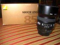 Near mint Nikkor 85mm f/1.8D lens. Great portrait lens.