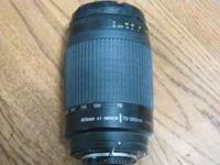 Nikkor lens AF 70-300mm 1:4-5.6G. This lens works