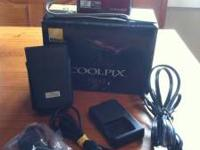 Very nice camera comes in original box with strap with