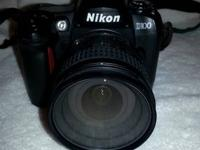 I am selling my lightly used Nikon D100 with 18-70 AFS