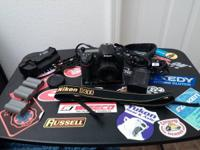 I'm offering my hardly used Nikon D300 with a 50mm 1.8