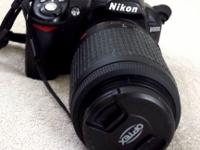 Nikon D3100 14.2 MP Digital SLR Camer/55-200 lens Comes