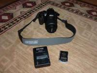 Nikon D3100 camera with 18-55mm lens, two batteries,