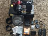 Electronic camera and lenses are in ideal condition.