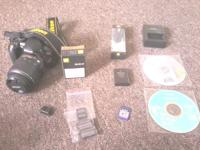 Nikon D3100 camera base 18-55mm lens 4GB SDHC memory