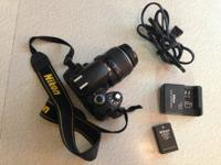 This is a Nikon D40 digital SLR camera. I believe the