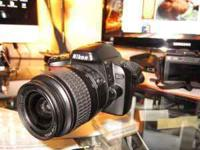 NIKON D40 DSLR camera with 18-55 mm auto focus lens.