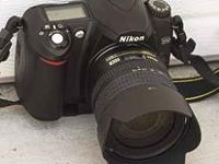 NIKON D50 with 18-55 mm digital lens. This camera has