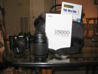 Like new with additional 55-200mm lens.  Includes