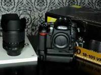 Like new Nikon D7000 with 18-105 with batterygrip and a
