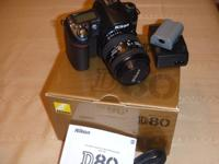 Nikon D80 with zoom lens in excellent condition.  Lens