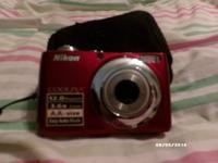 Red nikon digital cam hardly made use of at all. It's