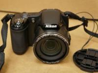 Nikon Coolpix L820. Includes carrying case. See photos
