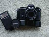 Nikon EM with 50 mm lense with SB flash. All work needs