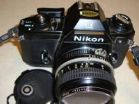 a Nikon 35mm Camera with 50 mm lens, also 35 mm lens,