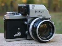 Nikon F model camera with standard 50 mm 1.4 lens.