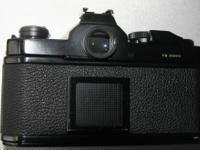 Nikon FM 35mm camera with Nikkor 43-86 mm zoom lens in