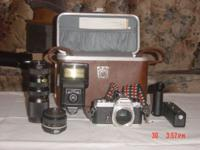 Nikon fm slr camera with a Nikon 50mm lens AND WITH