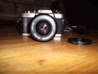 Nikon FM-10 camera with flash for sale. The camera has