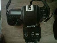 I have a Nikon N50 35mm (takes film) camera in