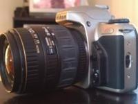 Great condition nikon n65 slr camera. Comes with