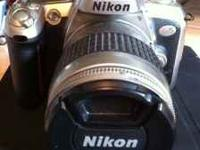 Nikon N75 35mm SLR Camera with 28-80mm lens. Gently