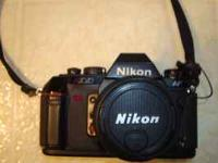 Nikkor 50mm f1.8 lens, Nikon flash (SB-20), leather