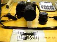 Nikon FM1 35mm camera with MD11 Motordrive--28mm