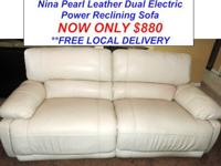 . Right here is a LIKE NEW Power Dual Reclining Cream