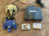 Nintendo 64 with 2 controllers. Utilized however