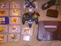 Nintendo system two controllers one memory card and 11