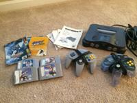 This is for a N64 console with 4 video games and two