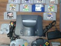 Nintendo 64, 2 controllers, 2 rumble paks, 10 games and