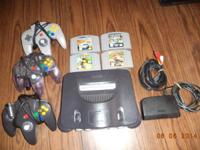 I AM SELLING MY NINTENDO 64 SYSTEM W / 3 CONTROLLERS
