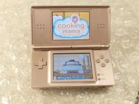 This is a Metallic Rose Nintendo DS lite. The console