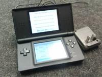 Nintendo DS Lite. We have 2 black and 1 white DS Lites.