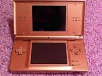 Nintendo DS Lite for sale. It's pink and the package