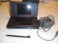 Selling Nintendo DS Lite Onyx Black with 3 games. Comes