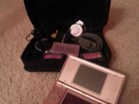 The Nintendo DS Lite is PINK in Mint condition.  Comes