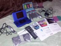 Nintendo DS with 8 games including Race Orama, 2