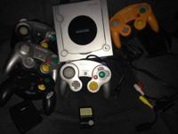 Gamecube plus 4 Nintendo controllers, and a Mad Katz