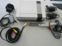 Lot includes: Nintendo Entertainment System A/C power